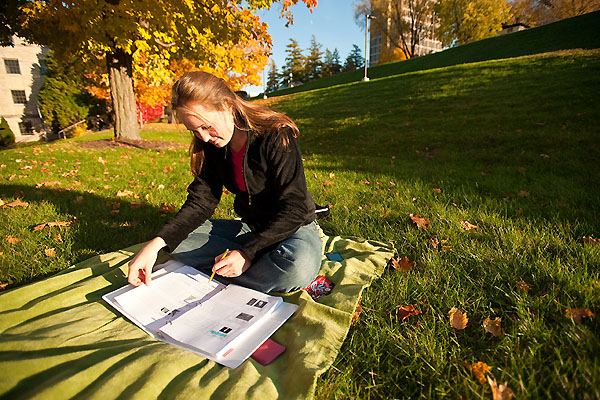 Student Sarah Allen studies for a test amid the autumn leaves on the hillside near the Observatory Drive Scenic Overlook at the University of Wisconsin-Madison on Oct. 27, 2009. ©UW-Madison University Communications 608/262-0067 Photo by: Bryce Richter Date:  10/09    File#:  NIKON D3 digital frame 1999